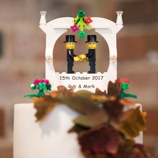 The couple's love of Lego was evident throughout their wedding and was also a cake topper on their wedding cake