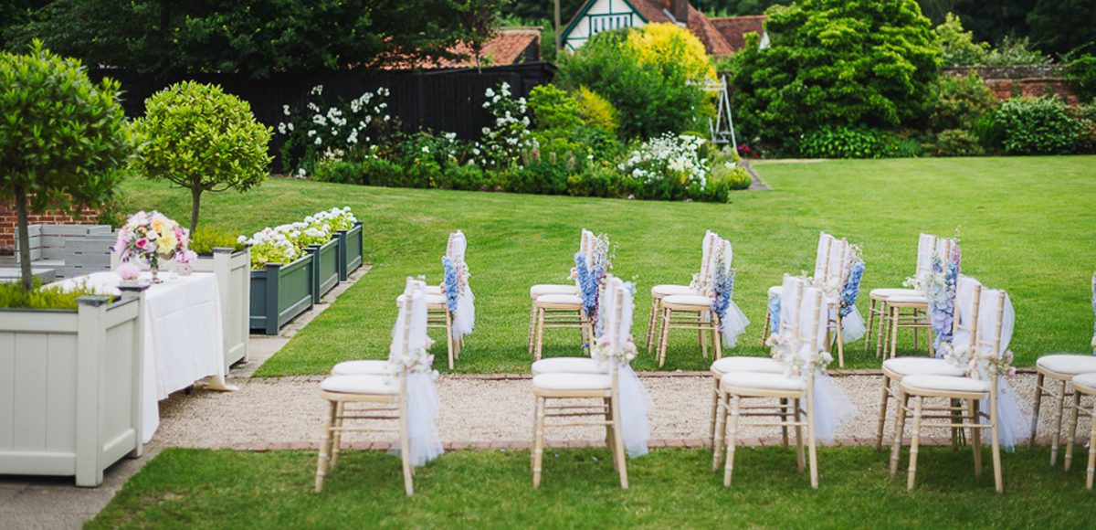 Wedding chairs lined up next to the pavilion at Gaynes Park