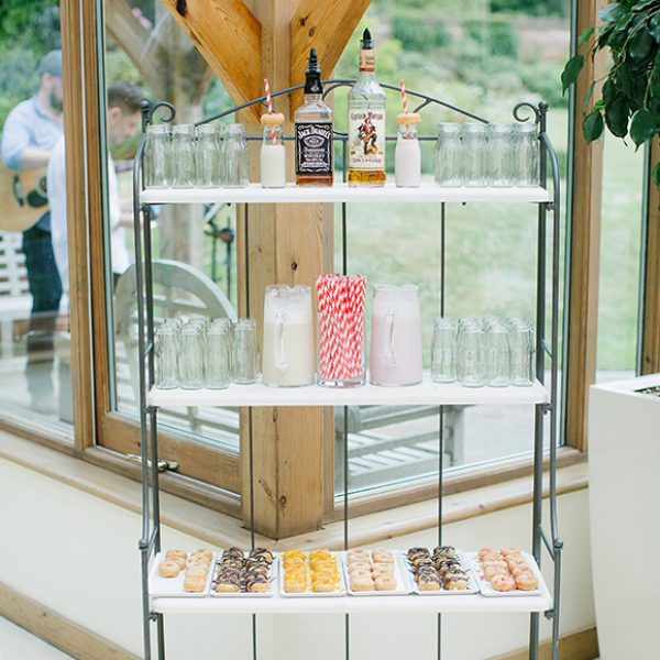 Guests are treated to flavoured doughnuts and milk at this fun spring wedding
