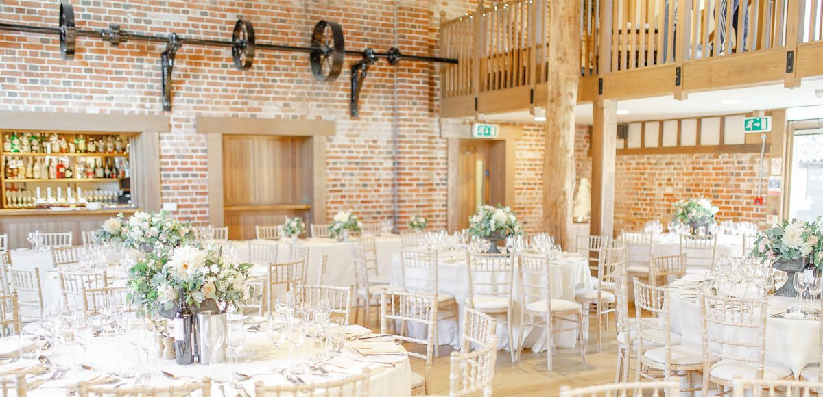 Set up for a beautiful wedding breakfast the Mill Barn at Gaynes Park creates a beautiful setting for a rustic country wedding