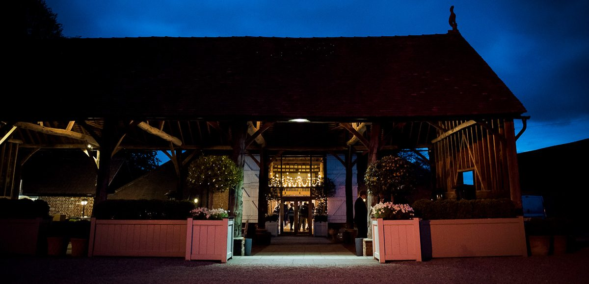 The Gather Barn at Gaynes Park in Essex looks stunning in the evening and is a perfect place for wedding guests to take a moment away from the dancefloor