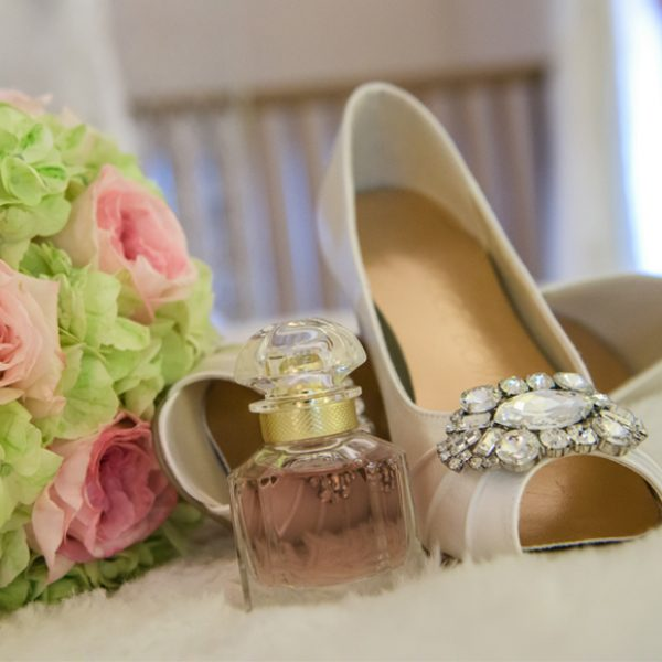 The bride wore classic wedding shoes along with her favourite perfume for her wedding at Gaynes Park in Essex