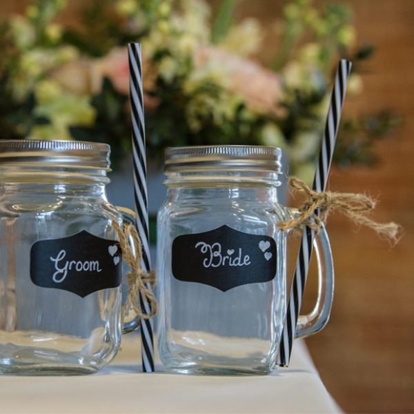 Bride and groom jam jar drinks glasses were perfect for cocktails after the wedding ceremony – wedding ideas