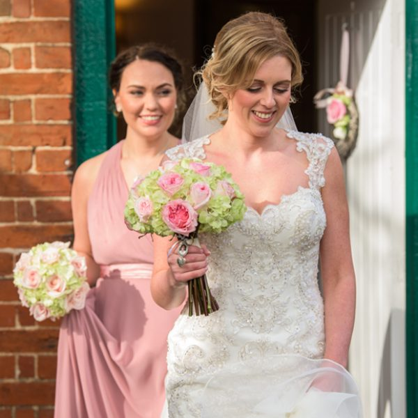 The bride and her bridesmaids leave the Appleloft Cottage at Gaynes Park ready for the wedding ceremony