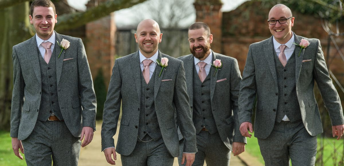 The groom and his ushers walk down The Long Walk ready for the wedding ceremony at Gaynes Park