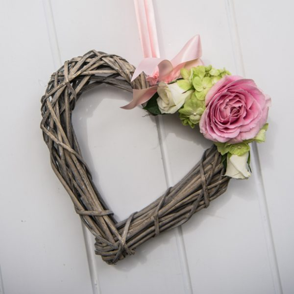 The Essex wedding venue was decorated with wicker hearts for a rustic wedding feel