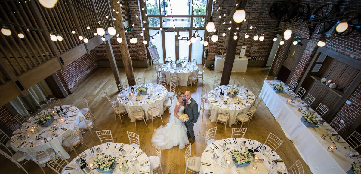 The new husband and wife await their guests for the wedding reception in The Mill Barn at Gaynes Park