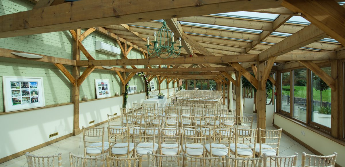 The Orangery at the Essex wedding venue is set up for a spring wedding ceremony