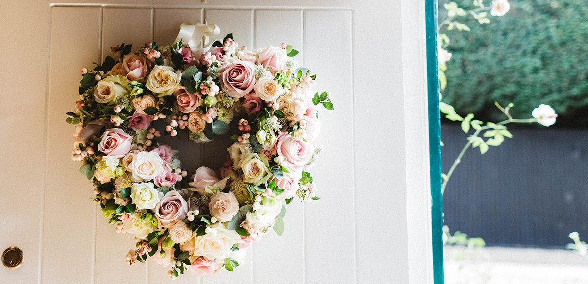 A heart is made up of beautiful pink roses for a vintage wedding look
