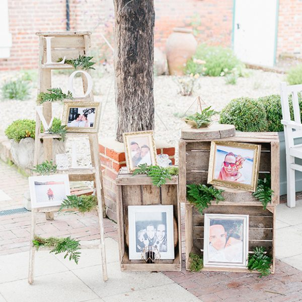 Pictures of the couple were displayed in apple crates for a rustic wedding look