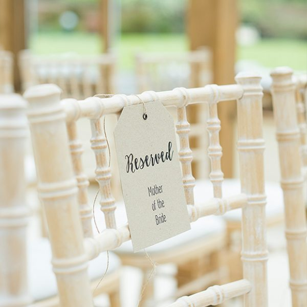 A tag attached to a chair in the Orangery at Gaynes Park creates a beautiful reserved seating sign