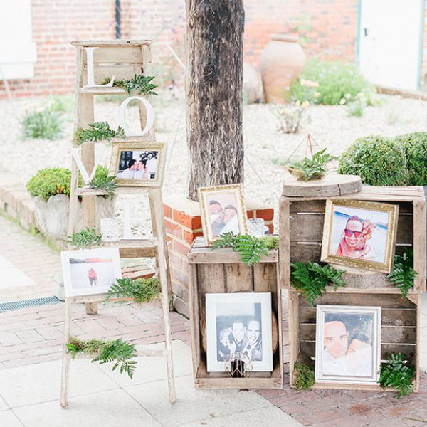 A selection of personal photos in vintage apple crates make for beautiful wedding décor – wedding ideas