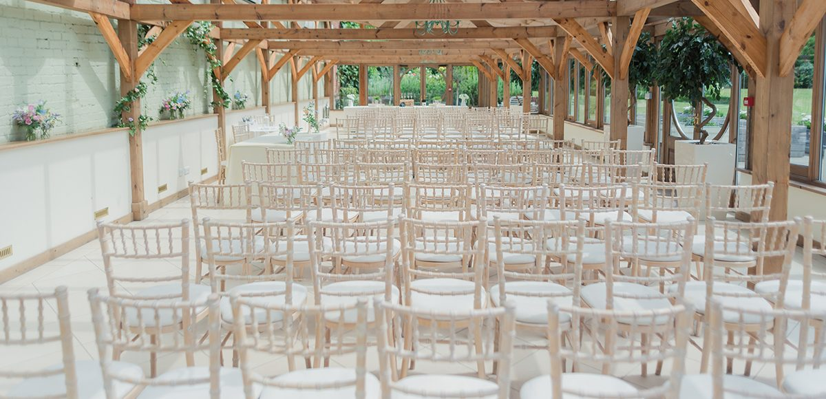 The Orangery at Gaynes Park wedding venue in Essex is set up for a beautiful spring wedding
