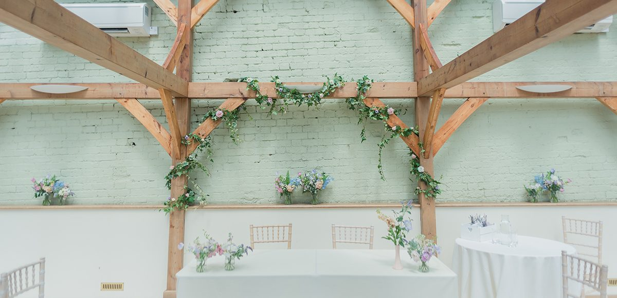 The Orangery at the Essex wedding venue is decorated with spring wedding flowers