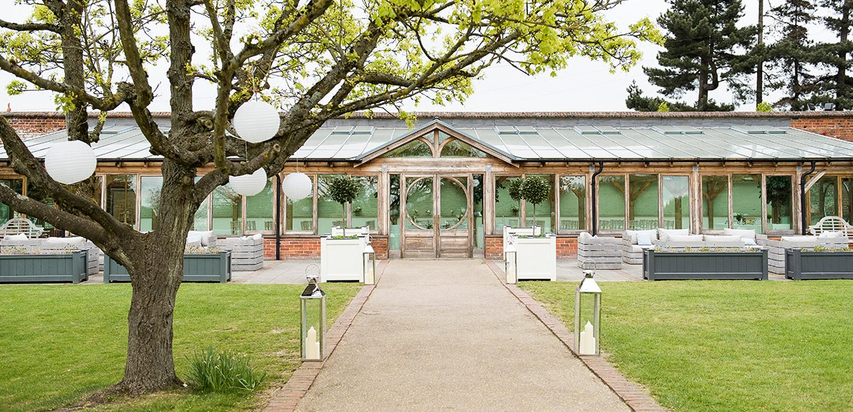 Line the wedding aisle up to the Orangery at Gaynes Park with lanterns or flowers