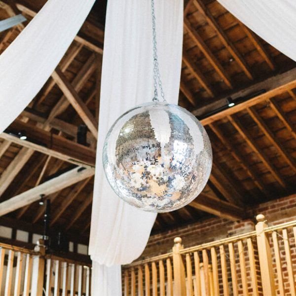 For the wedding reception a glitter ball hung from the ceiling in the Mill Barn at Gaynes Park