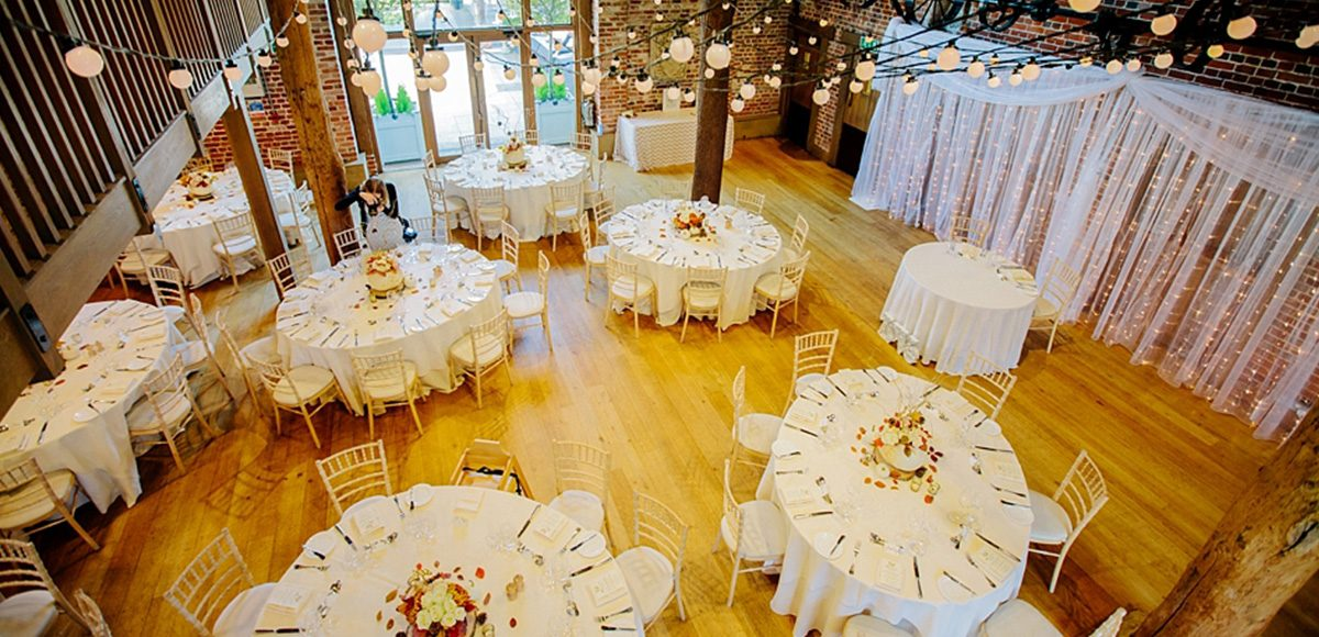 The Mill Barn at this Essex wedding venue is set up for a beautiful autumn wedding reception