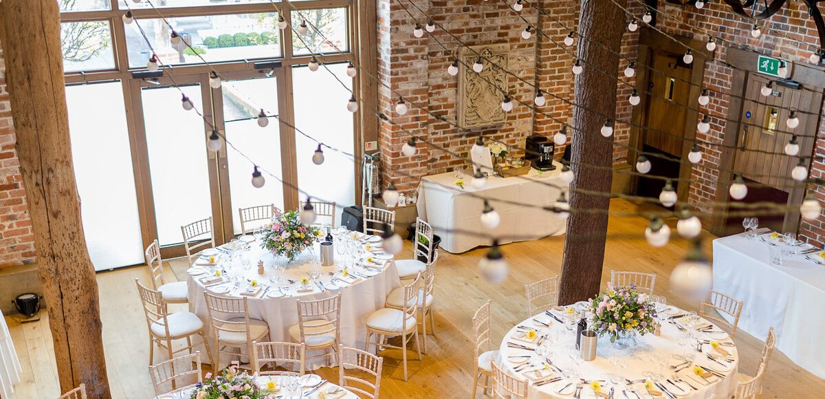 The newlyweds hung festoon lights within the Mill Barn for a rustic wedding look