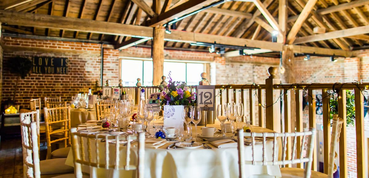 Couples can use the mezzanine in the Mill Barn at Gaynes Park for extra space on their wedding day