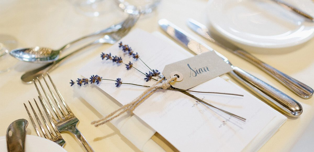 Rustic wedding stationery was used to decorate tables in the Mill Barn at Gaynes Park