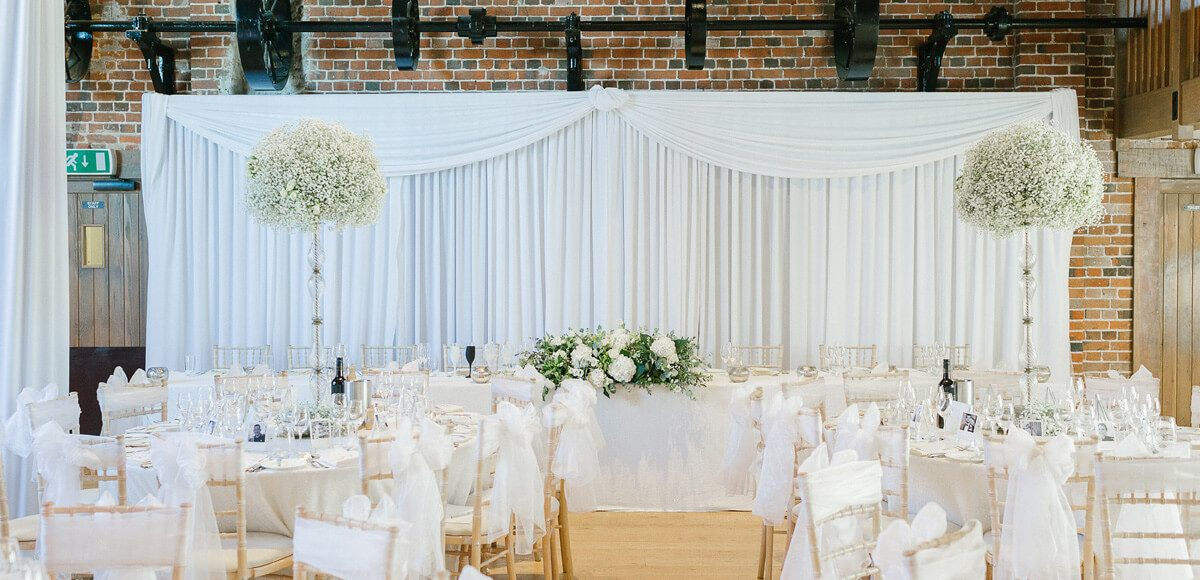Add a luxurious backdrop to your top table in the Mill Barn at Gaynes Park