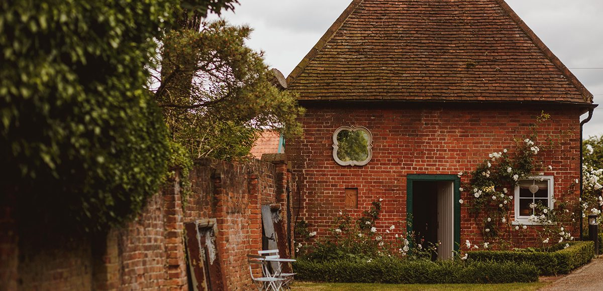 The bridal party prepared for the summer wedding ceremony in the Apple Loft Cottage at Gaynes Park