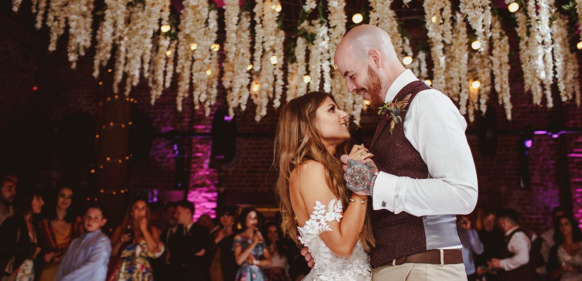 The couple perform their first dance as husband and wife in the Mill Barn at Gaynes Park