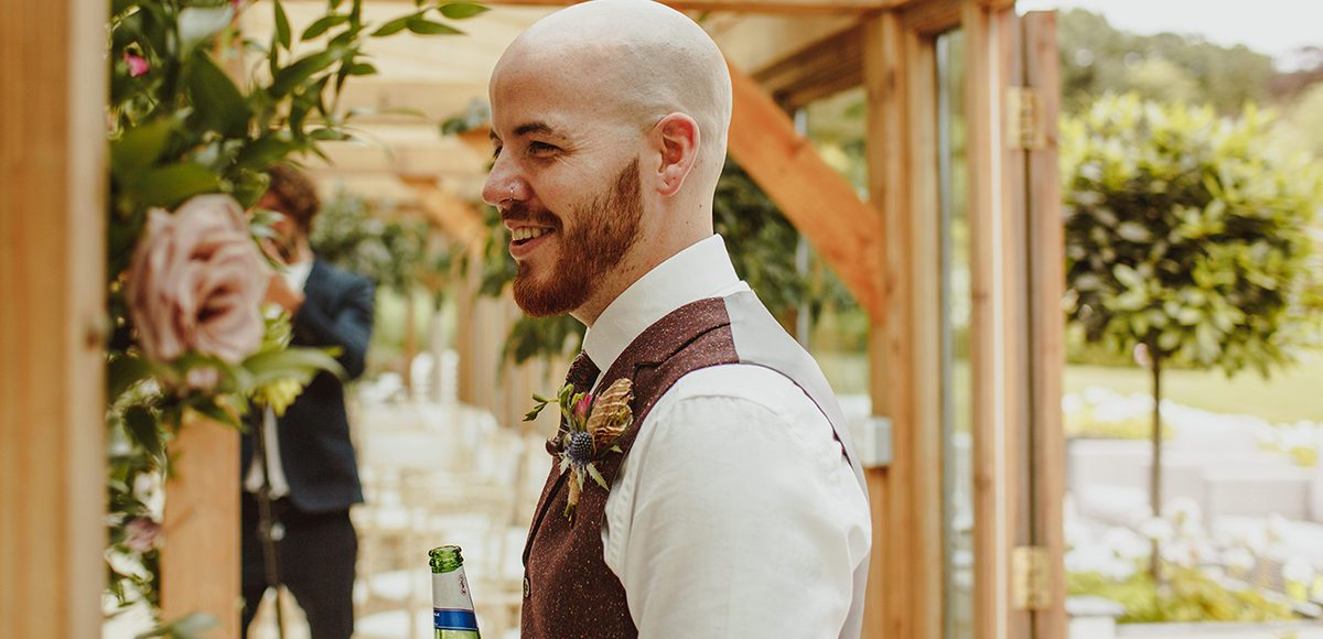 The groom wore a tweed suit as he waited for his bride in the Orangery at this Essex wedding venue