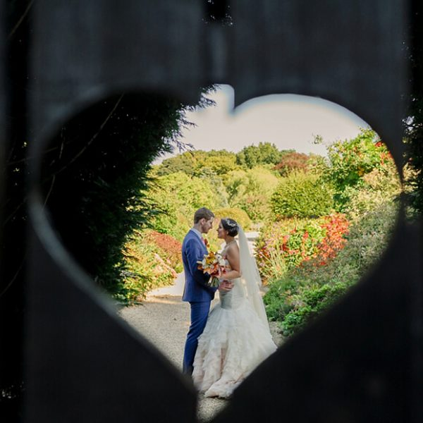 The heart gate at Gaynes Park is a beautiful frame for newlyweds to capture a stunning wedding photo