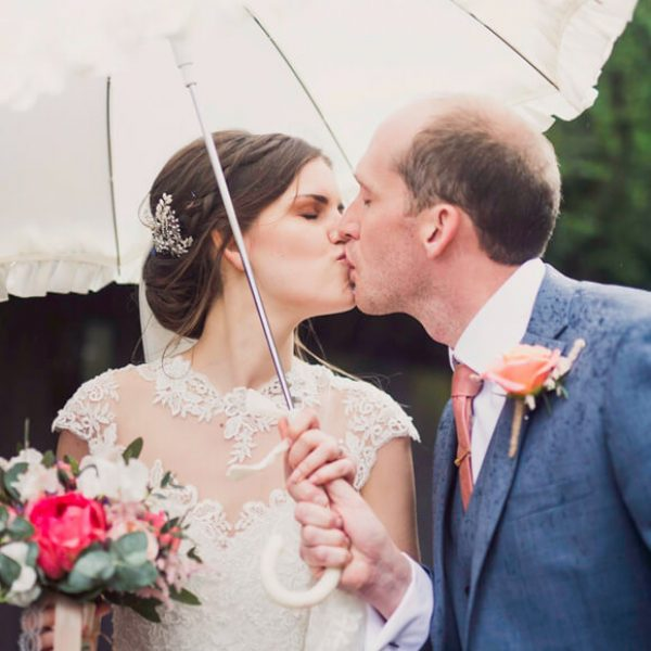 Newlyweds share a kiss in the gardens at Gaynes Park on their wedding day