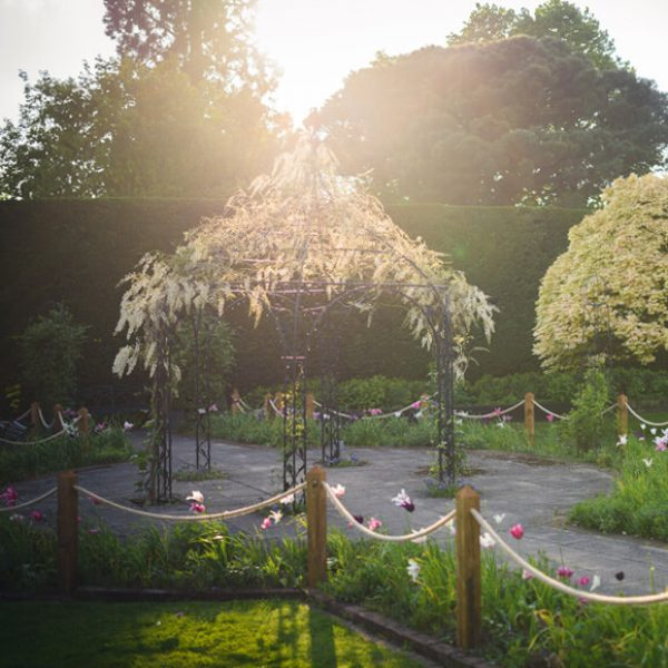 The sun shines down on the beautiful Pavillion that sits in the Walled Gardens at Gaynes Park wedding venue in Essex