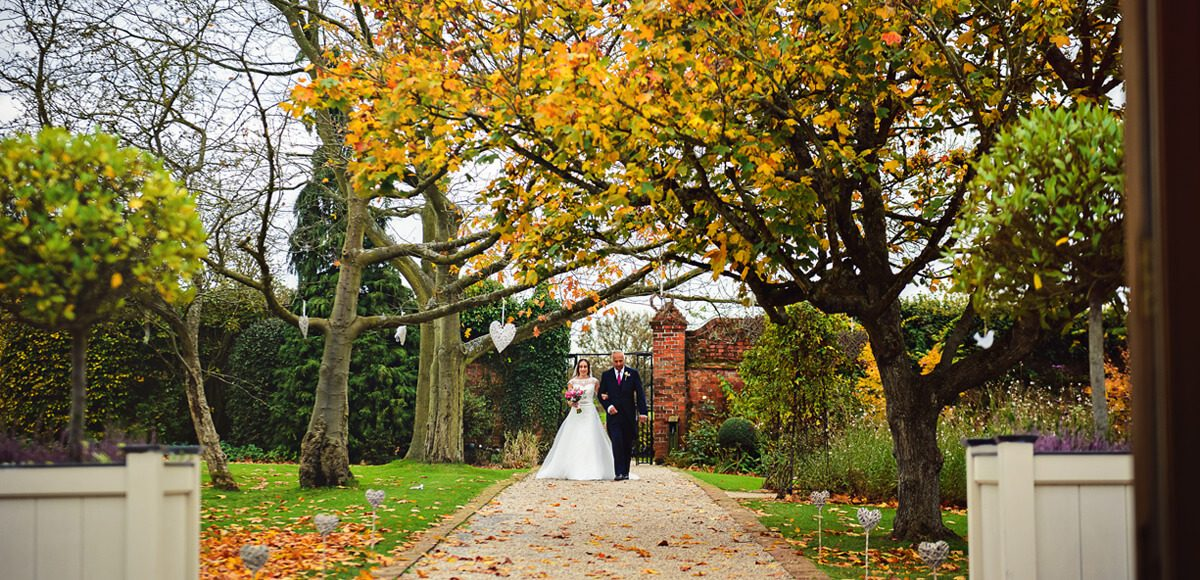 The wedding aisle in Gaynes Park's Walled Garden looks beautiful for an autumnal wedding