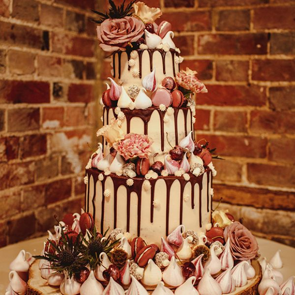 The wedding cake for this Gaynes Park wedding was decorated with meringues and macrons