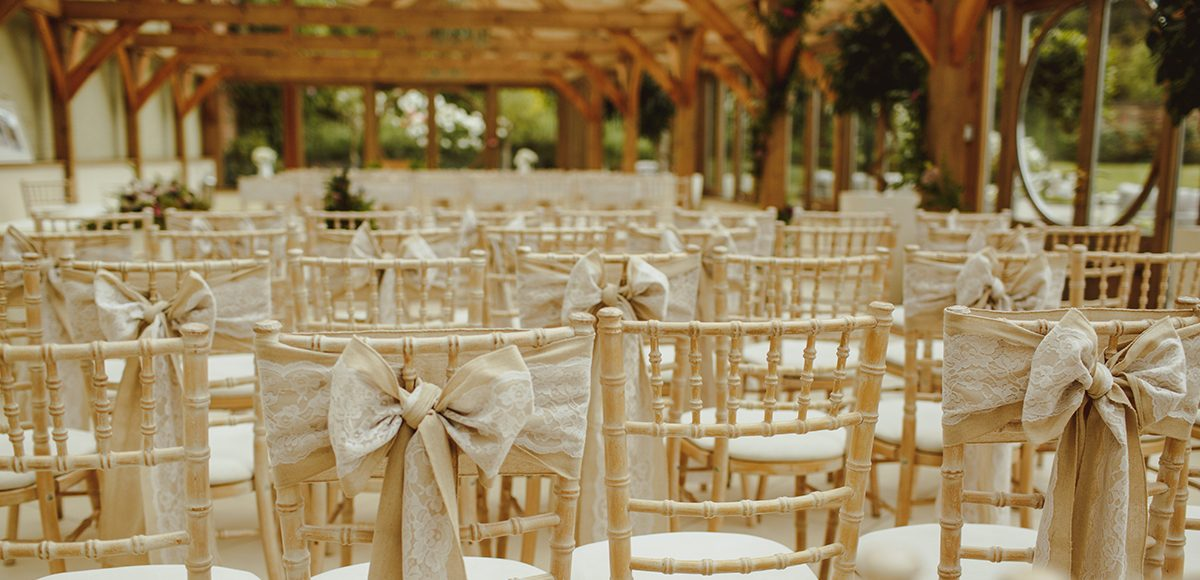 Hessian and lace chair sashes adorned the chairs for this summer wedding at Gaynes Park in Essex