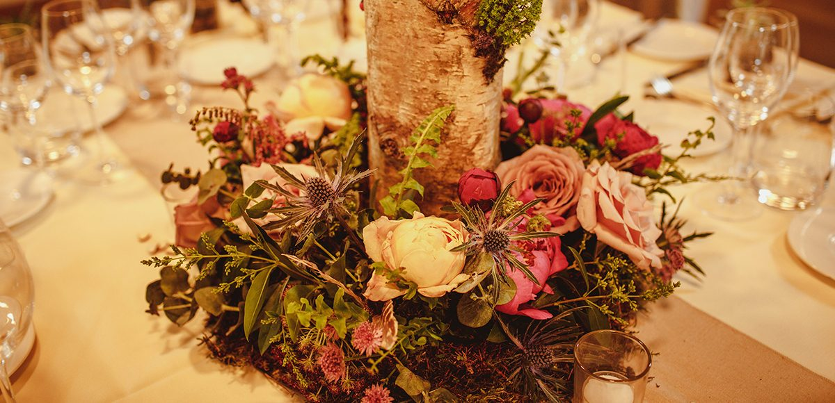 Vibrant wedding flowers added a pop of colour to this woodland themed summer wedding at Gaynes Park