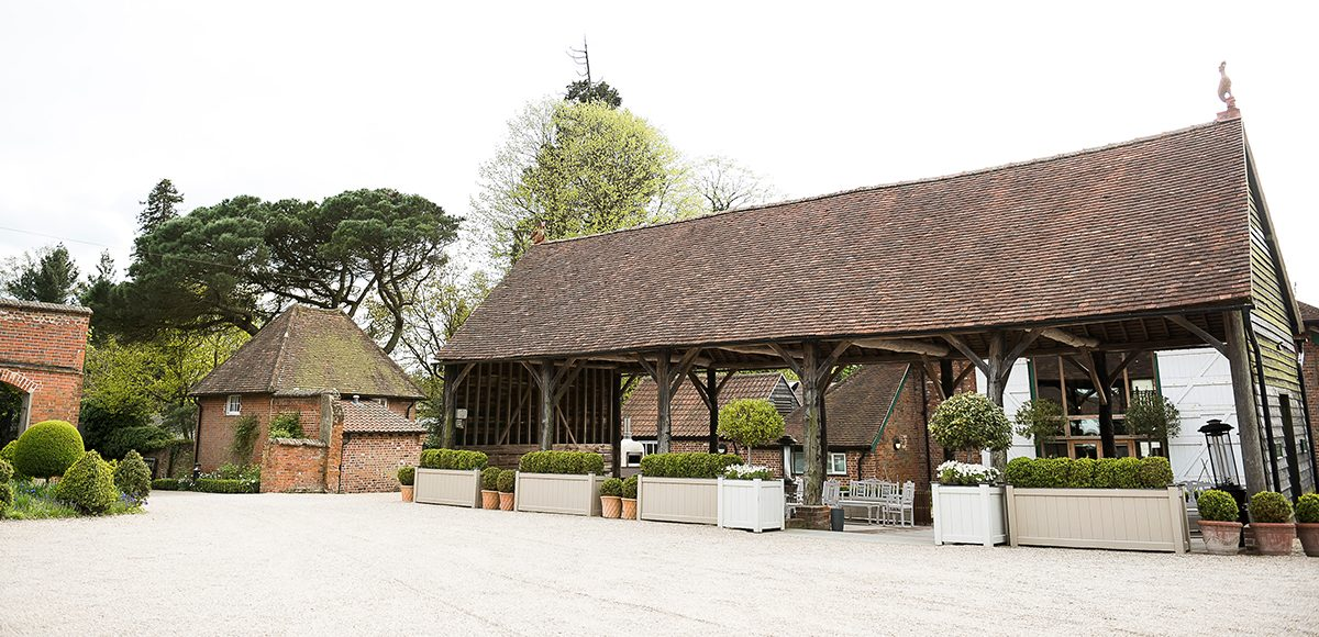 The Gather Barn at Gaynes Park is the perfect backdrop for a rustic wedding