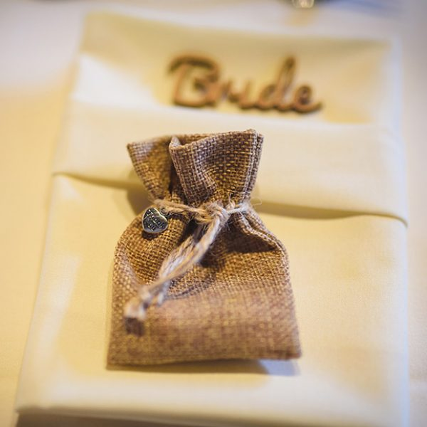 At Gaynes Park a couple put their wedding favours in a hessian bag for their rustic wedding