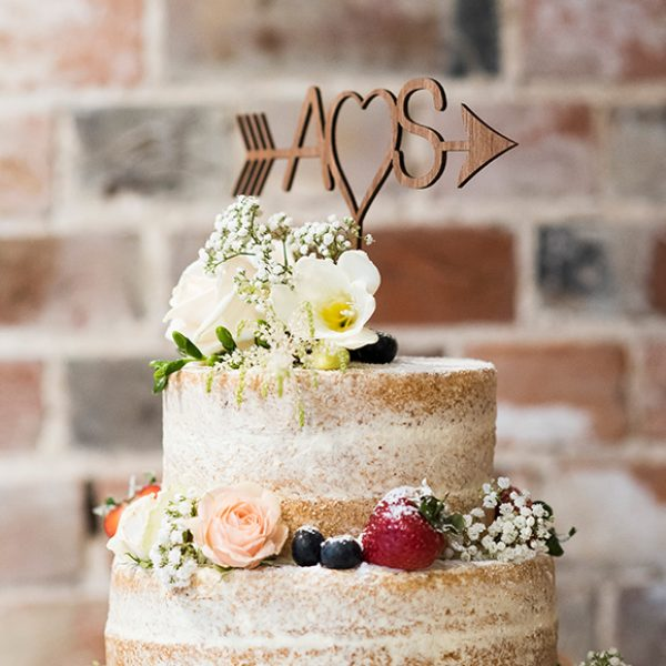 A naked wedding cake is the perfect choice for a rustic wedding at Gaynes Park