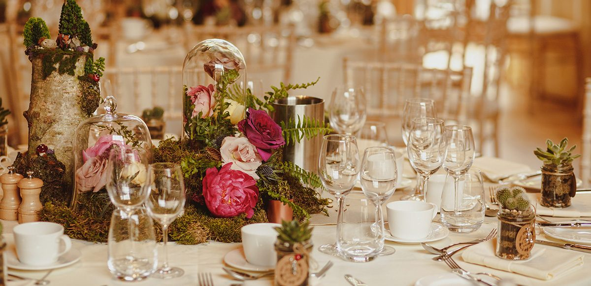 At Gaynes Park log slices and wedding flowers can bring a rustic wedding table centrepiece to life