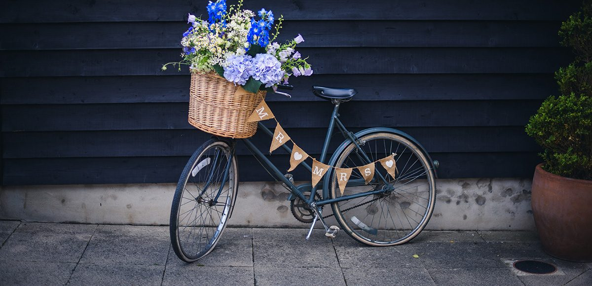 For their wedding at Gaynes Park a couple chose a vintage bike as a rustic wedding prop