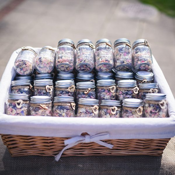 Jars of wedding confetti are perfect for a rustic wedding at Gaynes Park